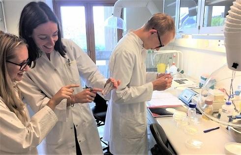 Team members doing lab work